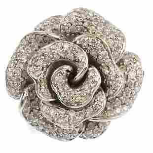 An 18ct gold diamond floral dress ring The paveset