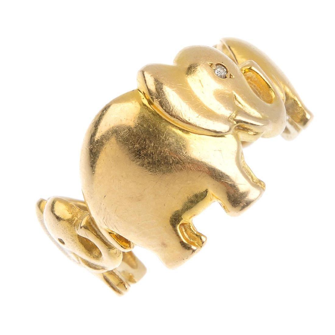 A diamond novelty ring. Designed as three graduated