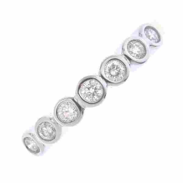 An 18ct gold diamond half eternity ring. The slightly