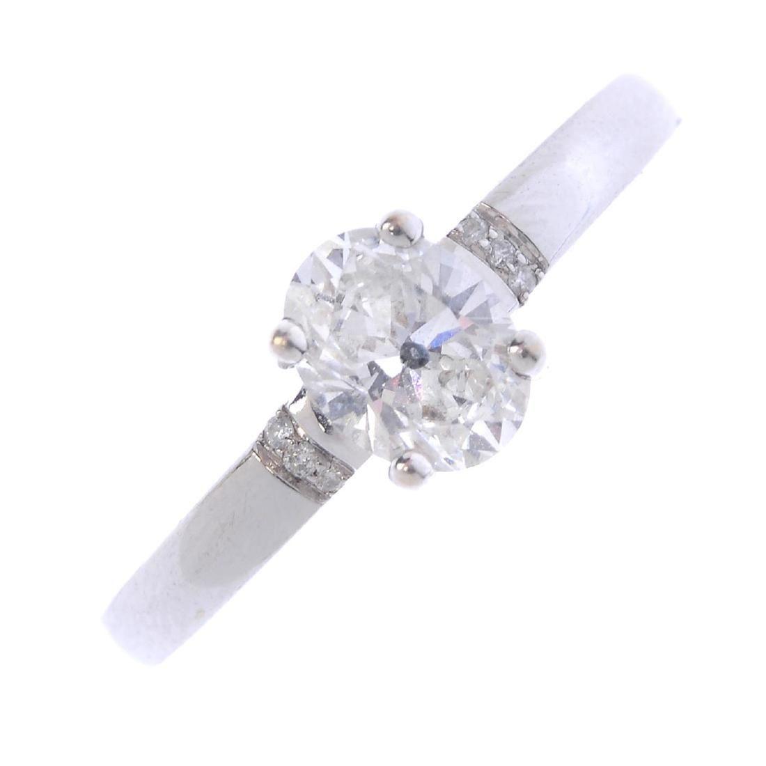 A diamond single-stone ring. The oval-shape diamond,