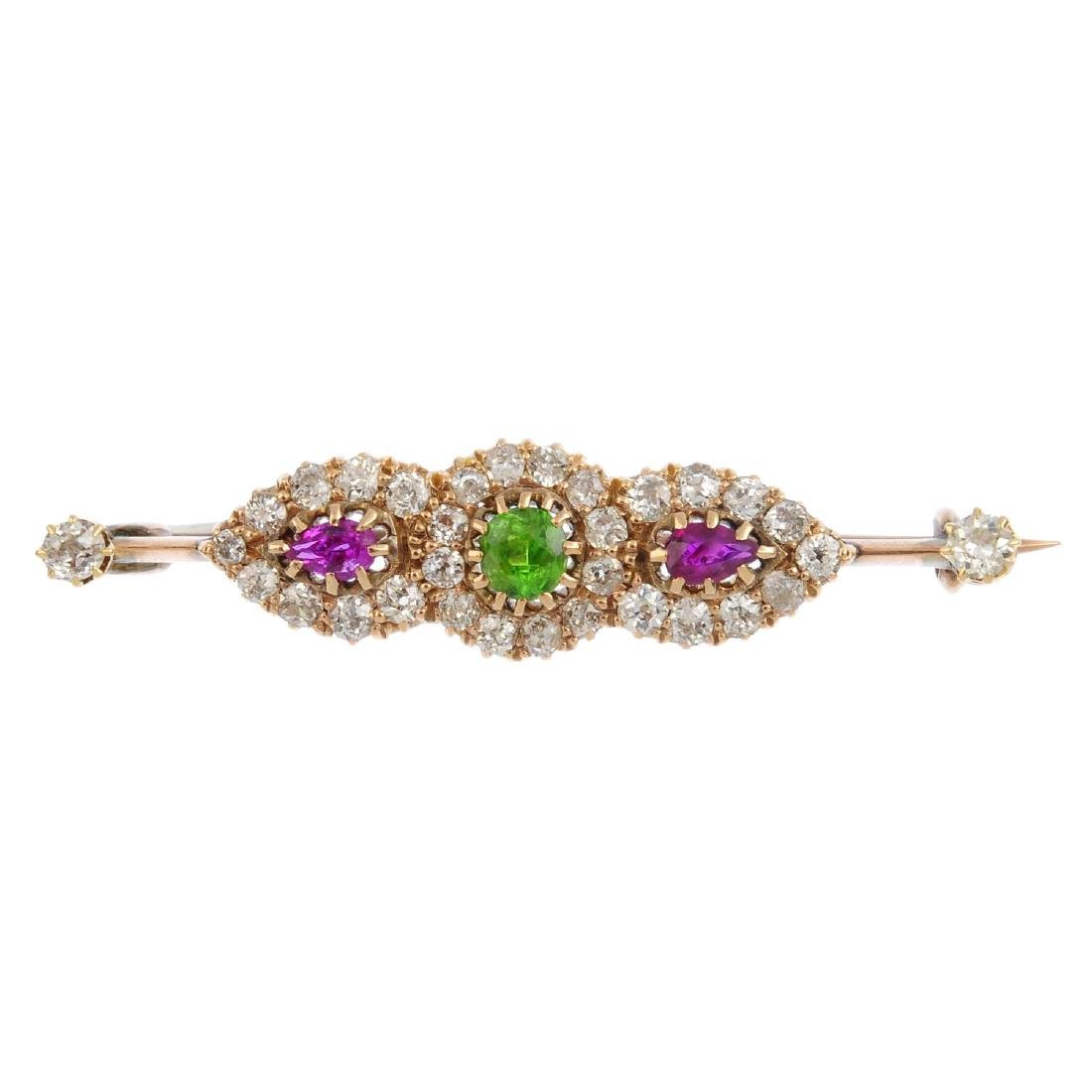 An early 20th century gold diamond and gem-set brooch.