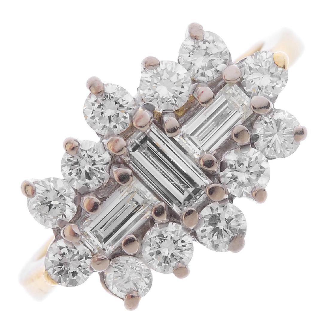 An 18ct gold diamond cluster ring. The alternately-set