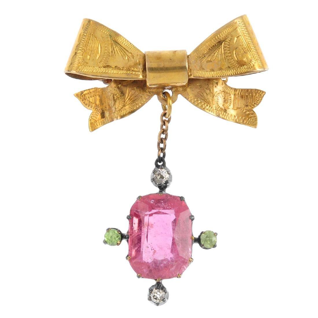 A gem-set brooch. The early 20th century cushion-shape