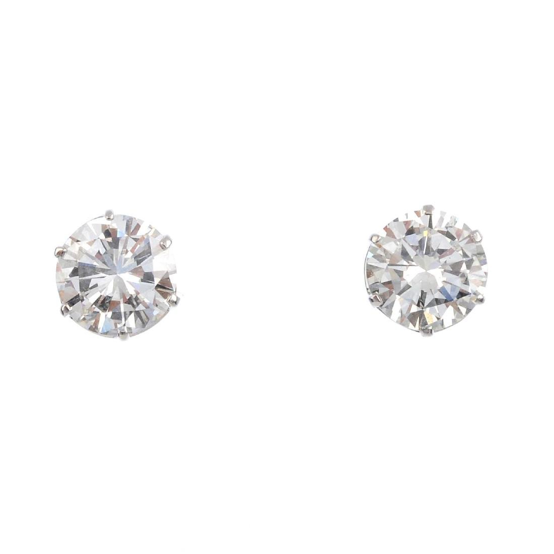 A pair of brilliant-cut diamond single-stone stud