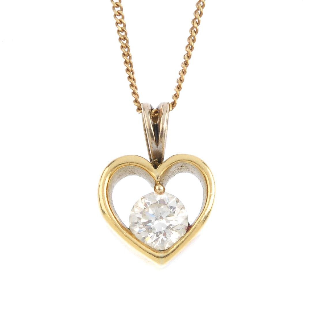 A diamond heart pendant. The brilliant-cut diamond,