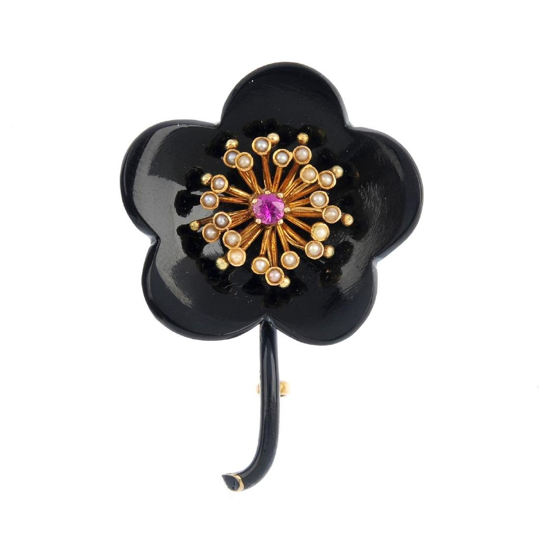 An early 20th century gold, gem-set floral brooch.