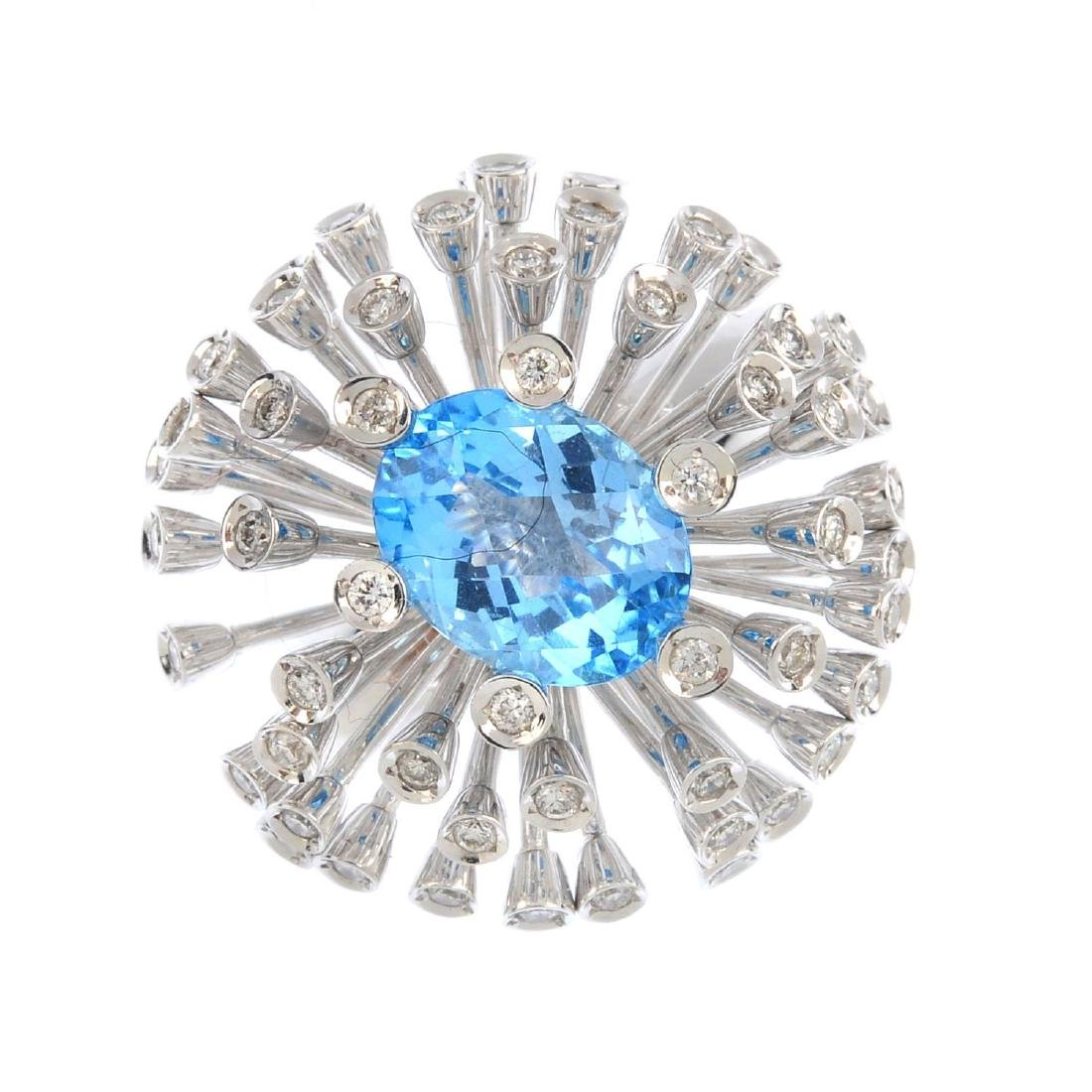 A topaz and diamond ring. Of bombe design, the
