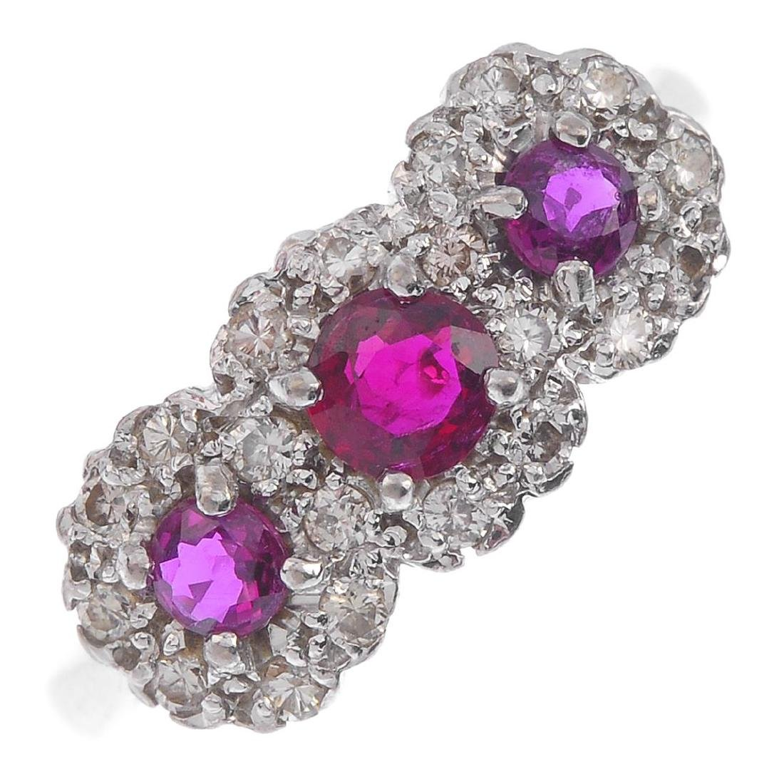 An 18ct gold ruby and diamond dress ring. The graduated