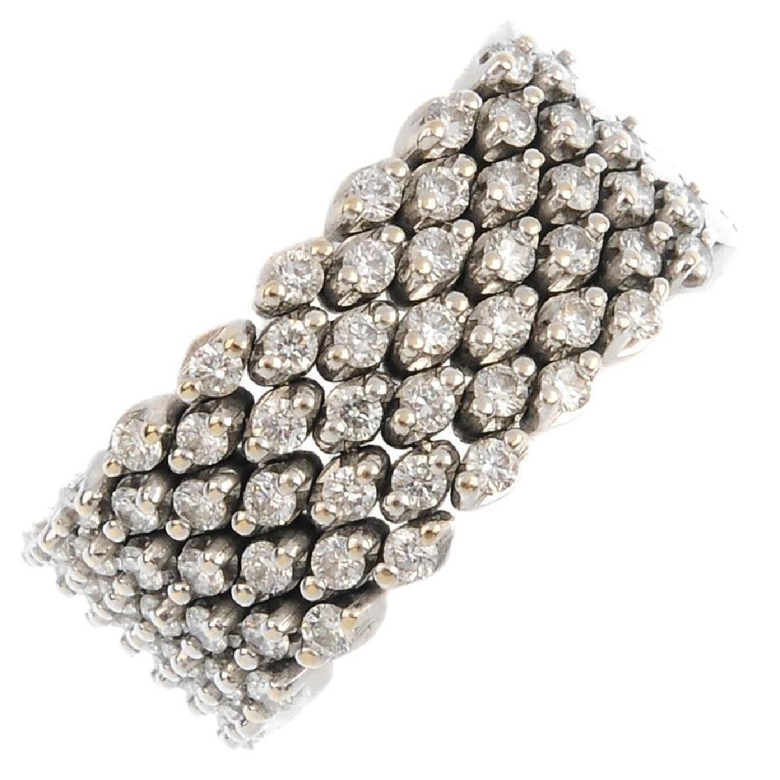 A diamond articulated ring. The brilliant-cut diamond