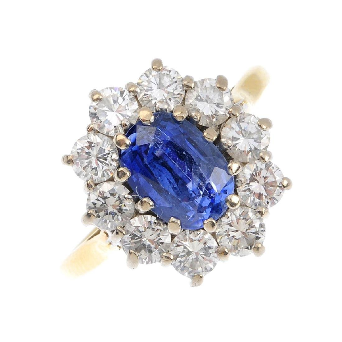 An 18ct gold diamond and sapphire cluster ring. The