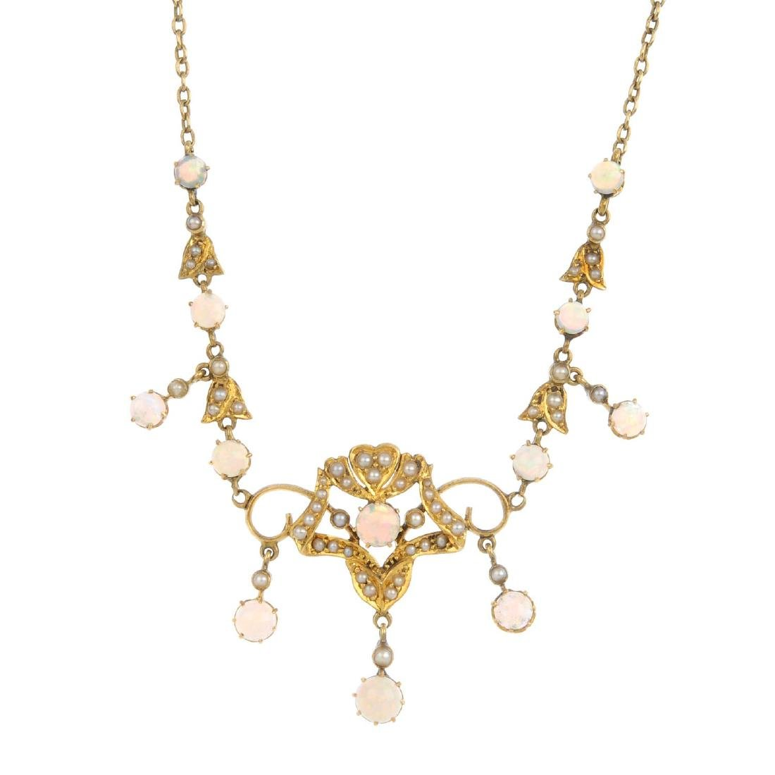 An early 20th century 15ct gold opal and split pearl