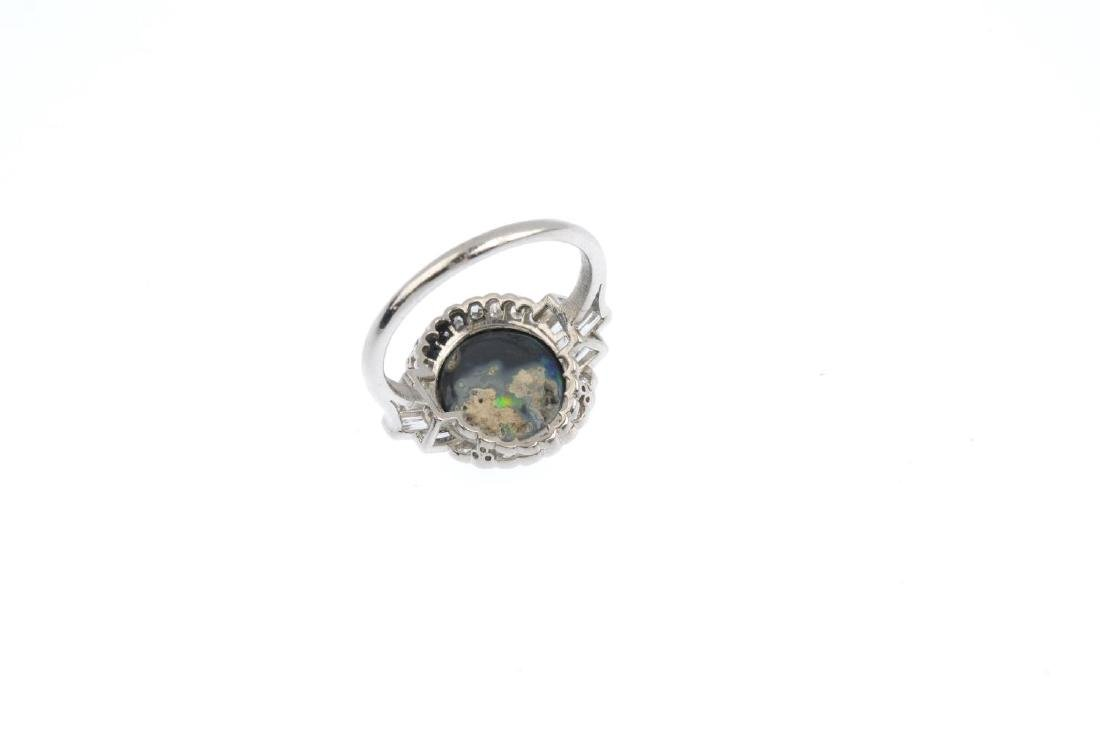A black opal and diamond cluster ring. The oval opal - 2