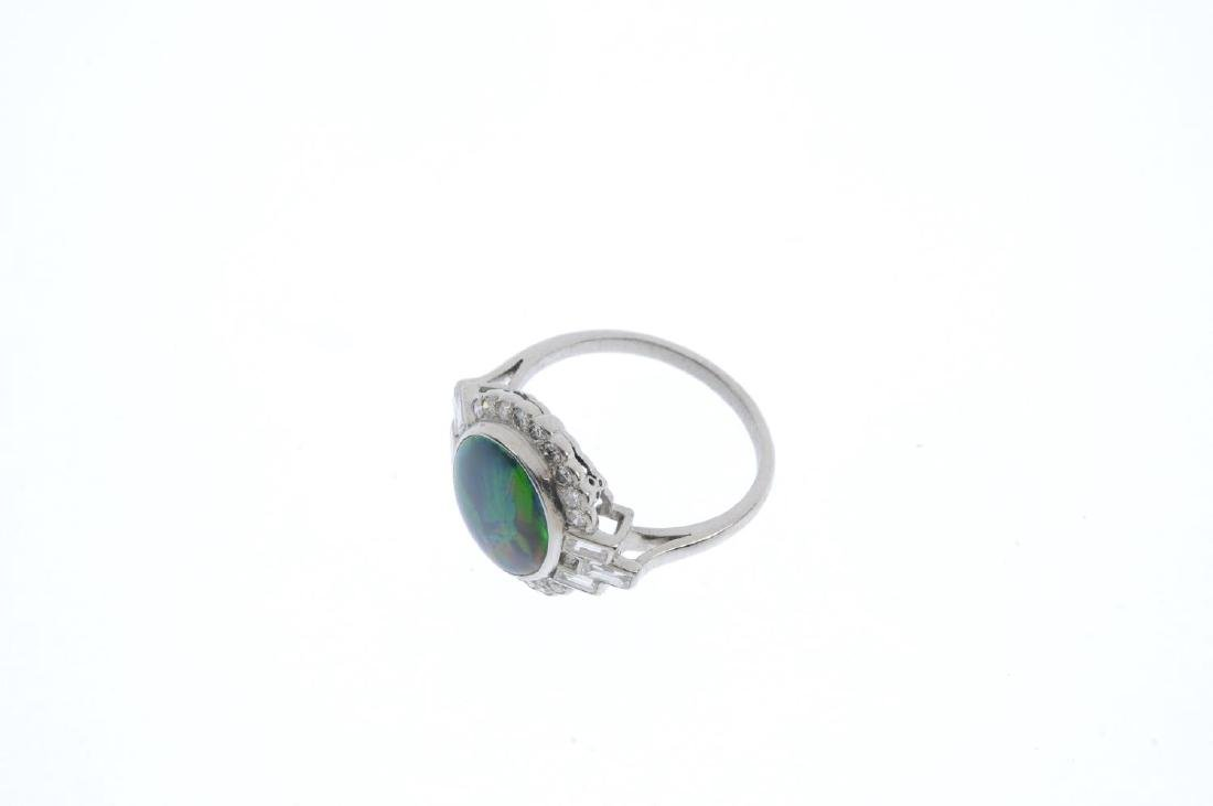 A black opal and diamond cluster ring. The oval opal - 3