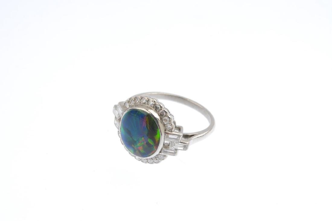 A black opal and diamond cluster ring. The oval opal - 4
