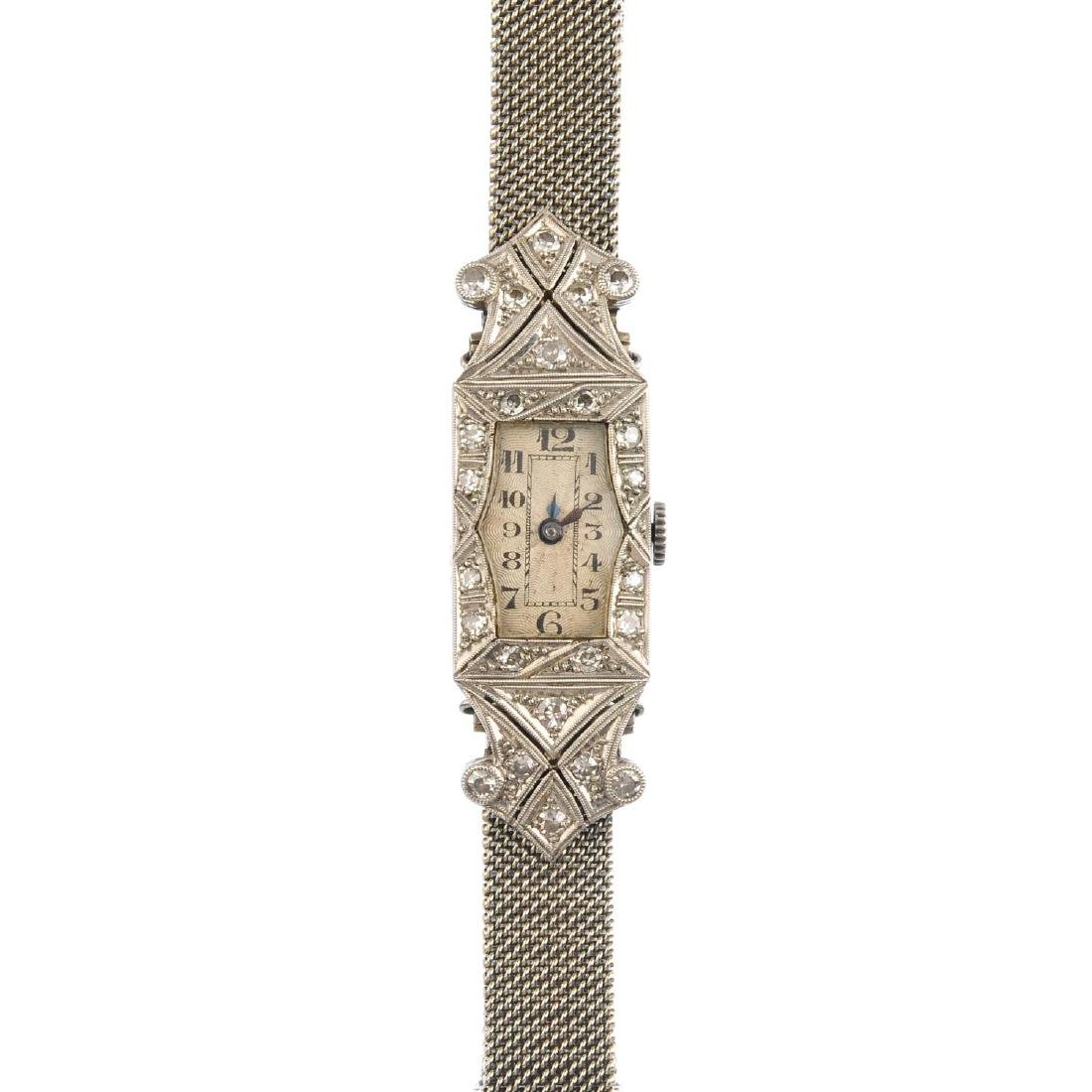 An early 20th century platinum and 9ct gold diamond