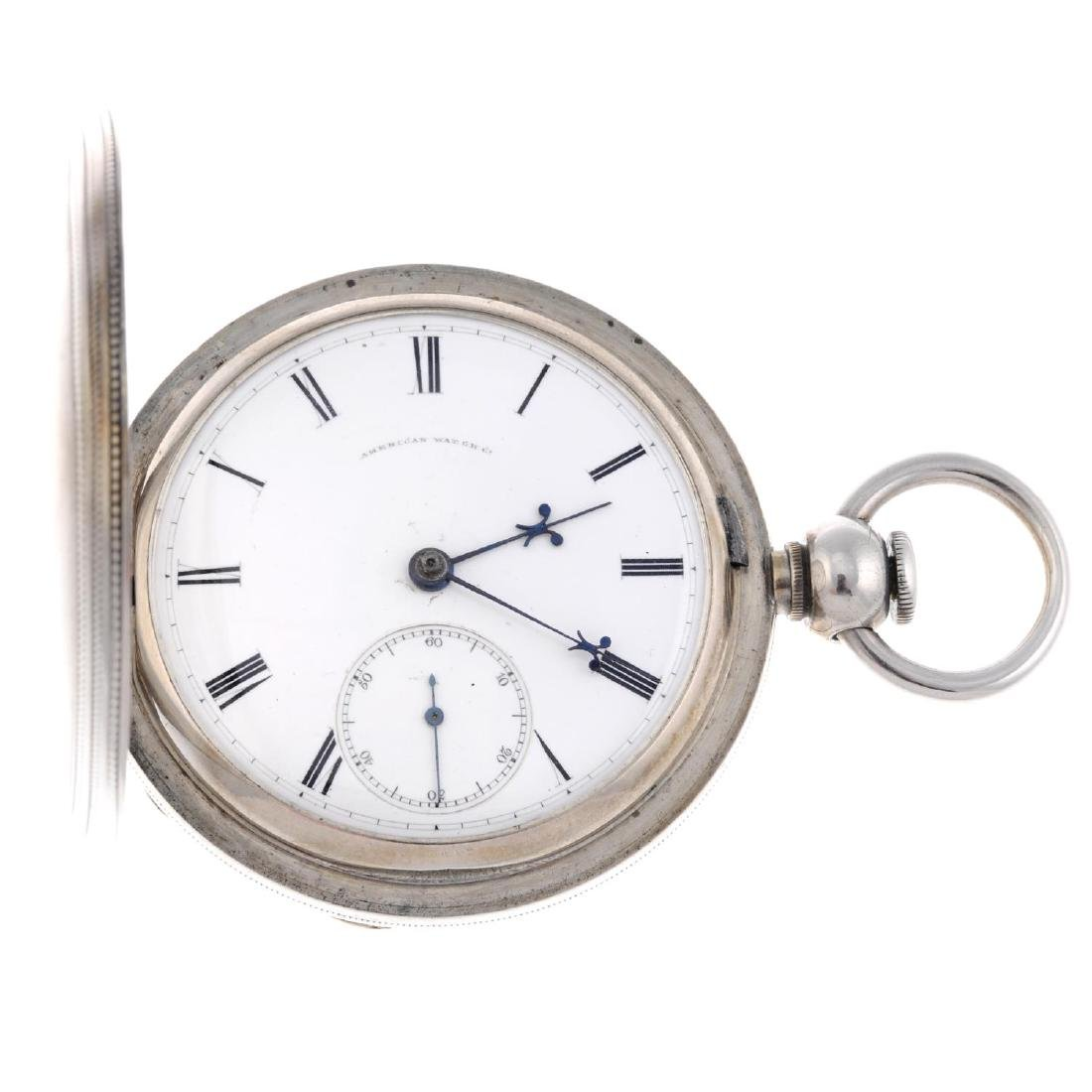 A full hunter pocket watch by Waltham. White metal