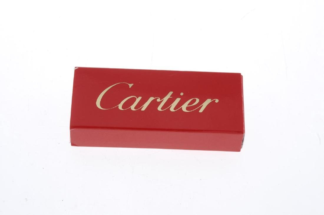 CARTIER - a stainless steel deployment clasp. Box. - 3