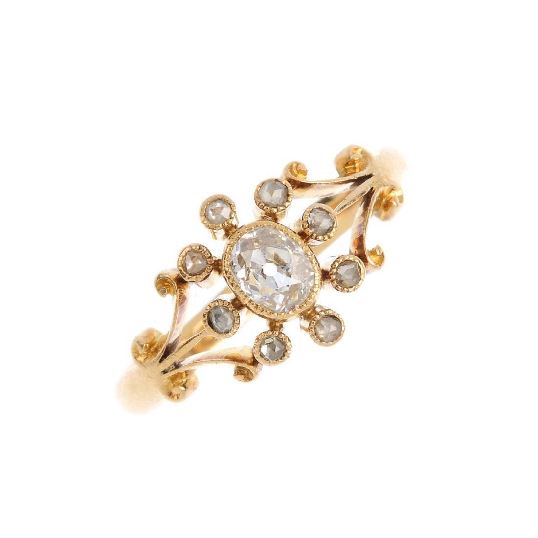 An Edwardian 18ct gold diamond dress ring. The old-cut