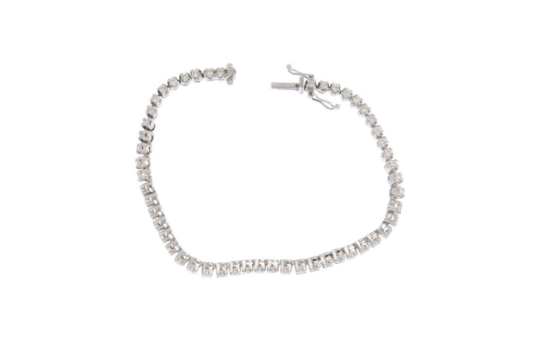 An 18ct gold diamond bracelet.  Designed as a series of - 3