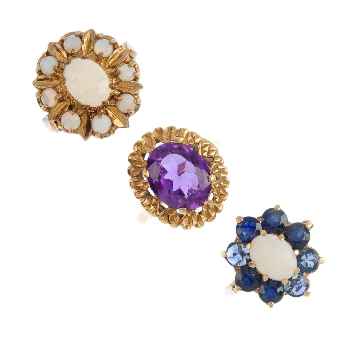 Three 9ct gold gem-set rings. To include an opal and