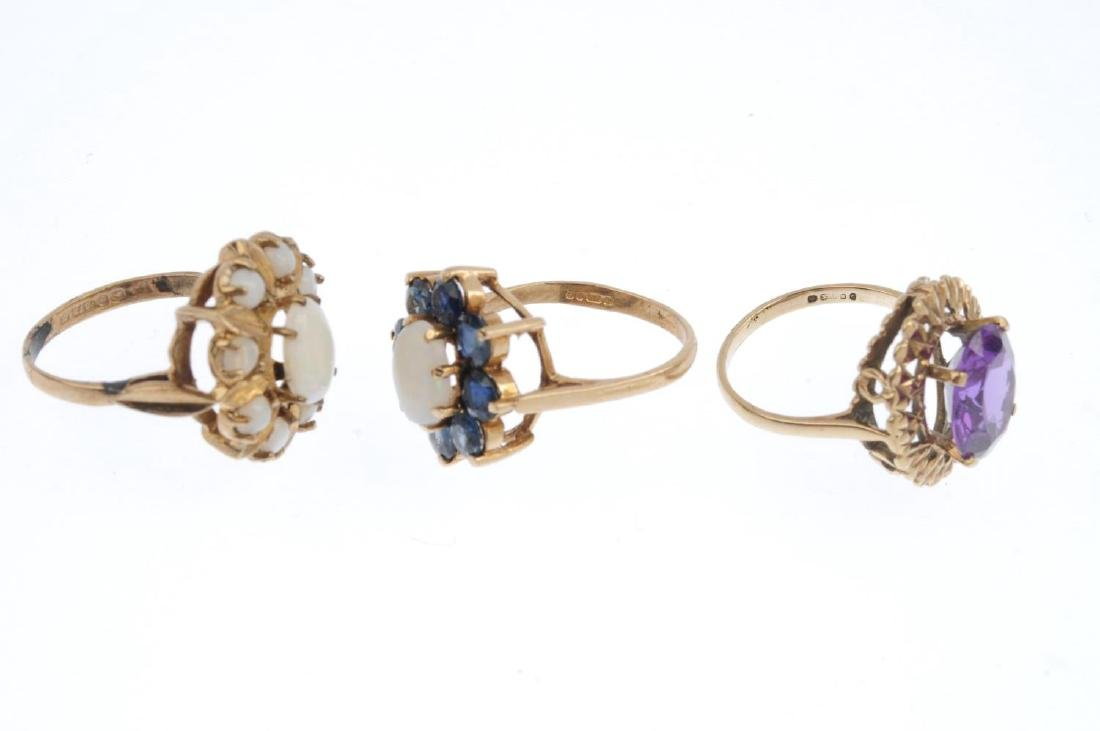 Three 9ct gold gem-set rings. To include an opal and - 3