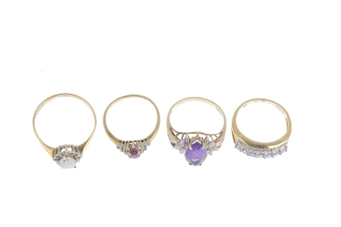 Four gem-set and diamond dress rings. To include a 9ct - 2