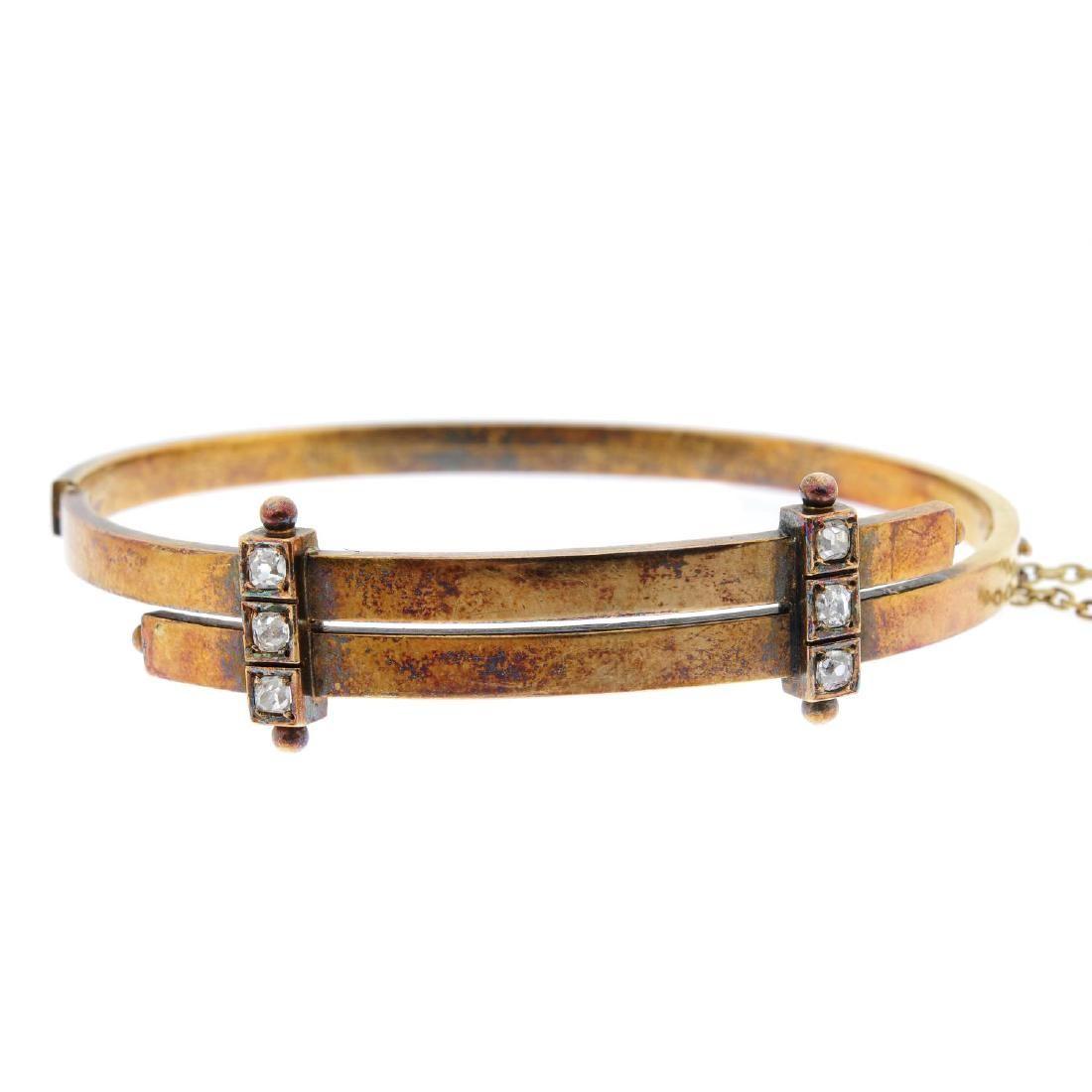 A late Victorian 15ct gold diamond hinged bangle.