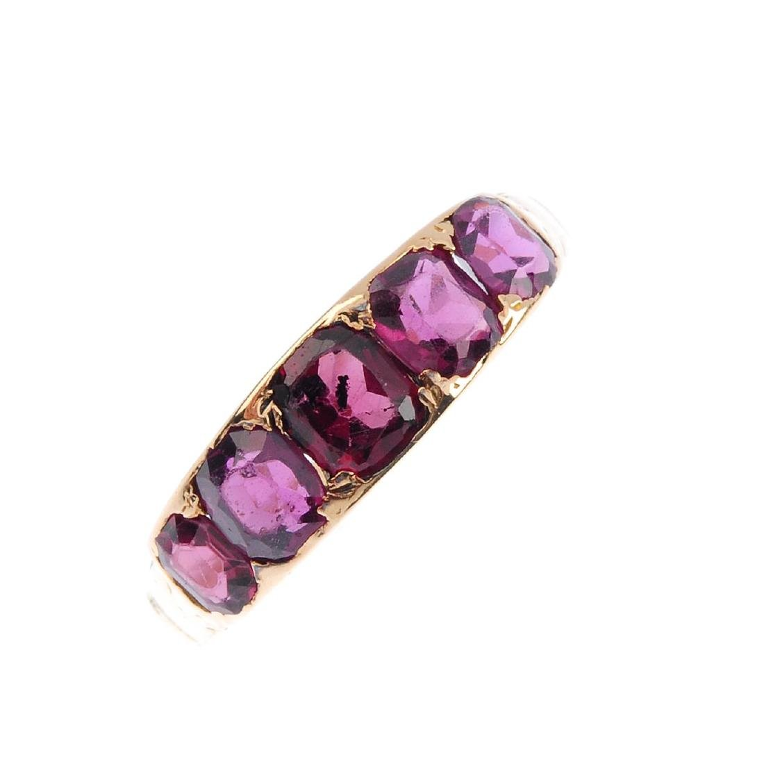 A garnet five-stone ring and two early 20th century