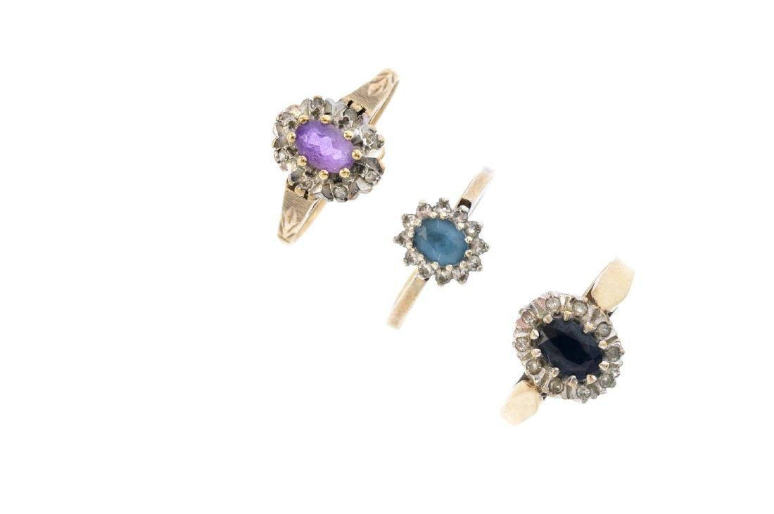 Five 9ct gold diamond and gem-set rings. To include a