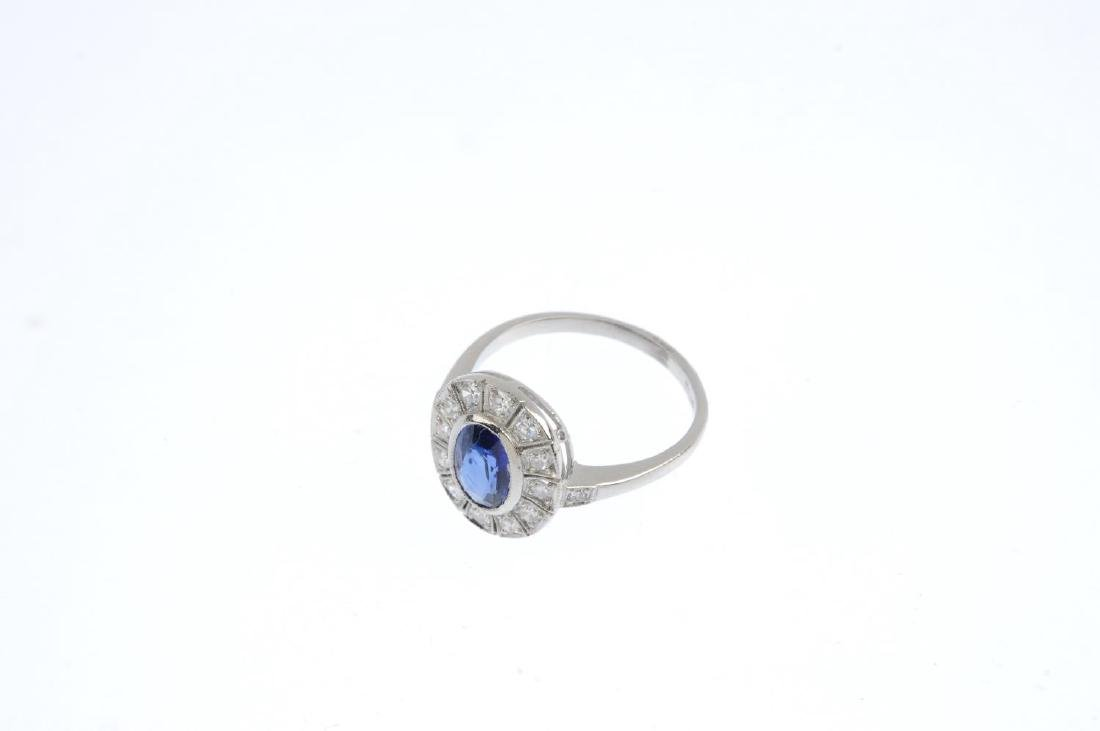 A sapphire and diamond cluster ring. The oval-shape - 2