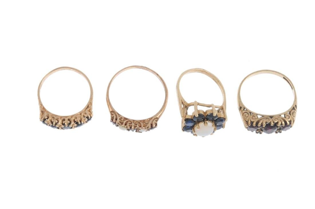 Four gem-set rings. To include a 9ct gold opal and - 2