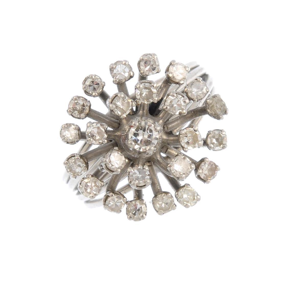 A diamond cluster ring. The single-cut diamond openwork