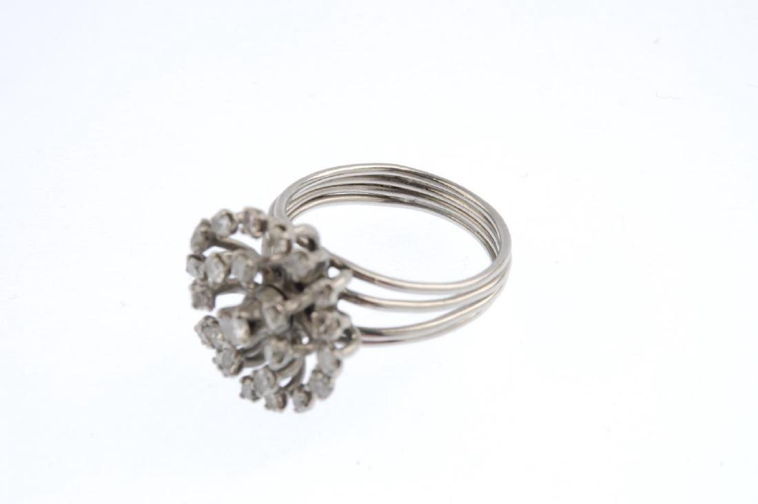 A diamond cluster ring. The single-cut diamond openwork - 3