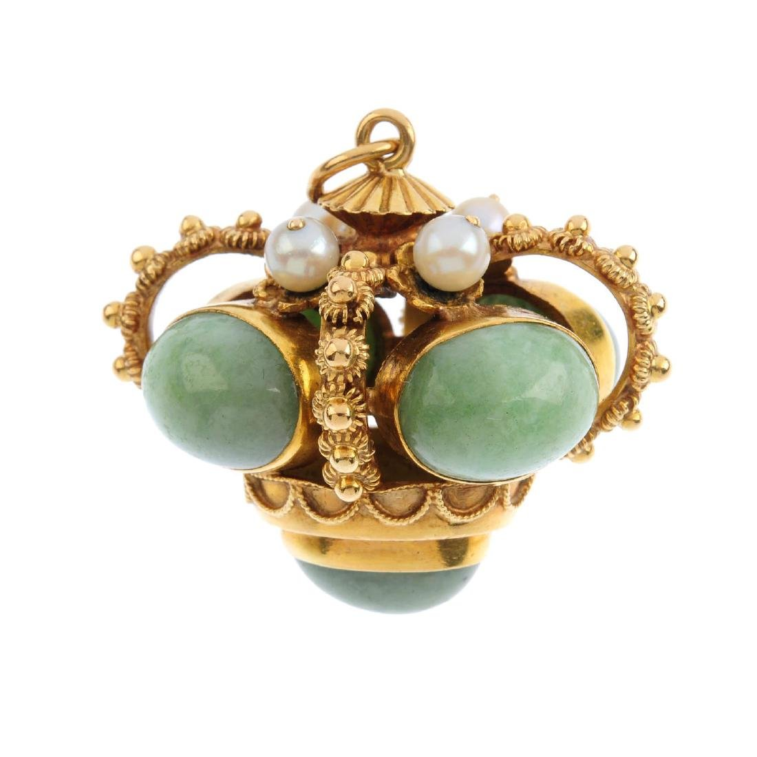 A gem-set fob. The oval green gem cabochon collets,