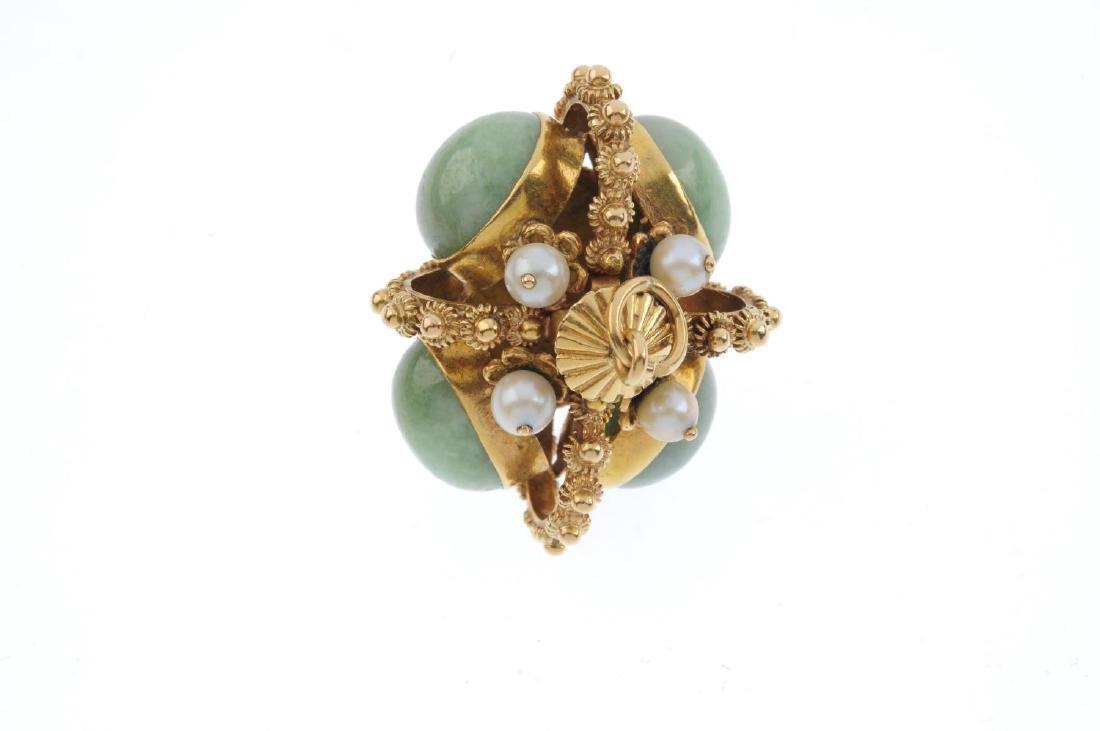 A gem-set fob. The oval green gem cabochon collets, - 2