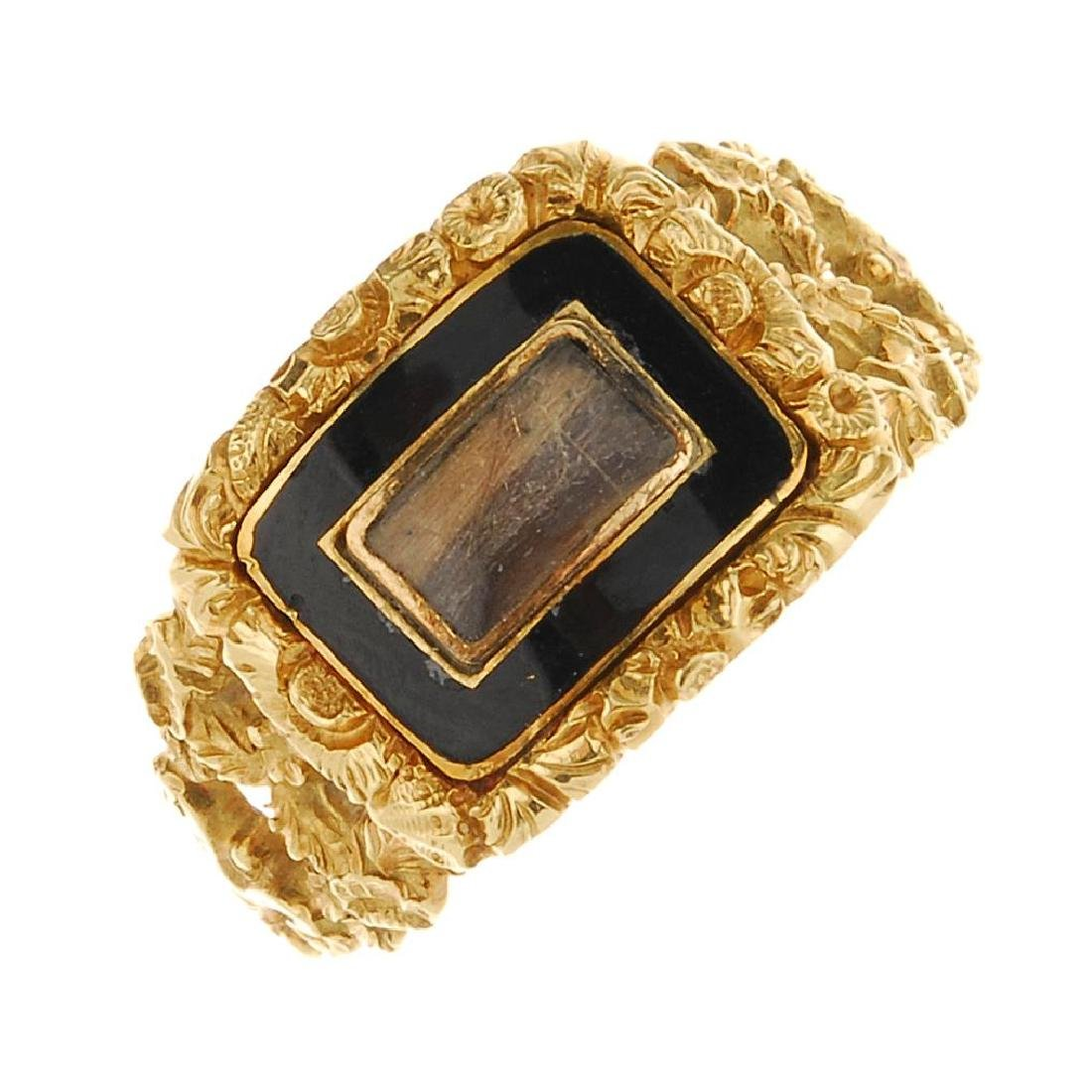 A George IV 18ct gold enamel memorial ring. Designed as