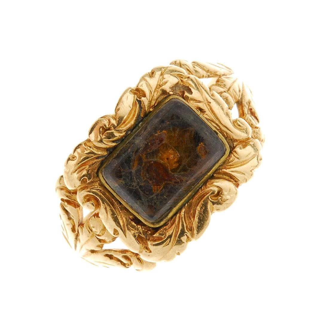 A late Georgian 18ct gold memorial ring. The central