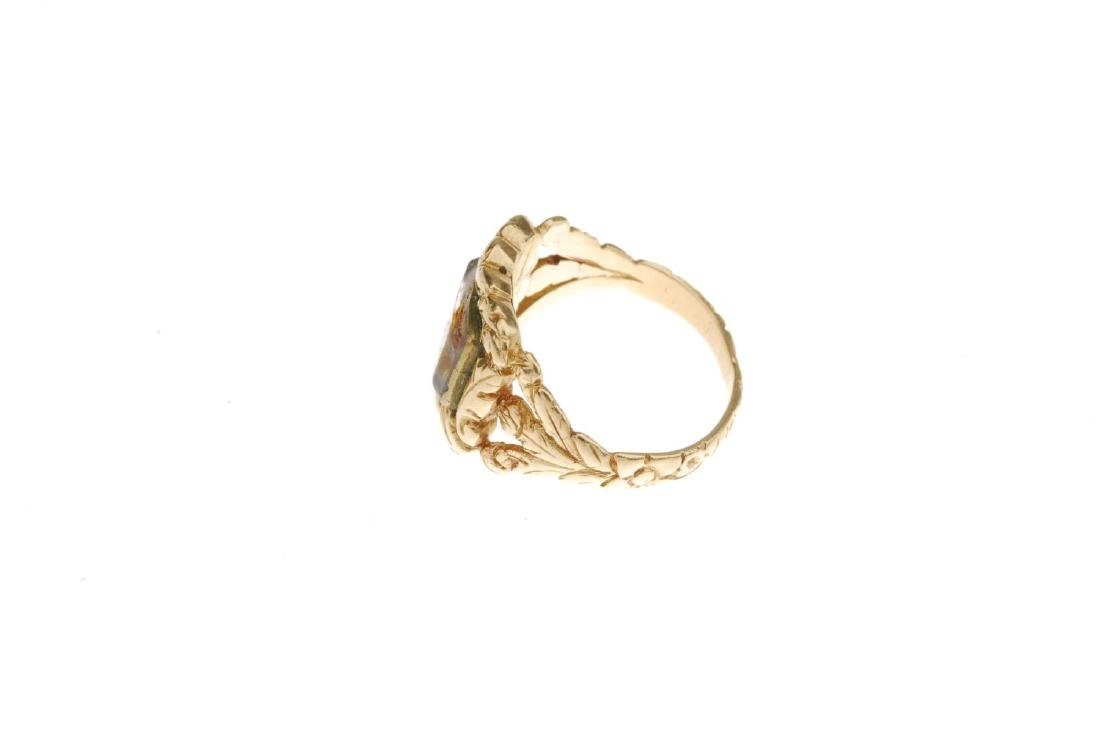A late Georgian 18ct gold memorial ring. The central - 2
