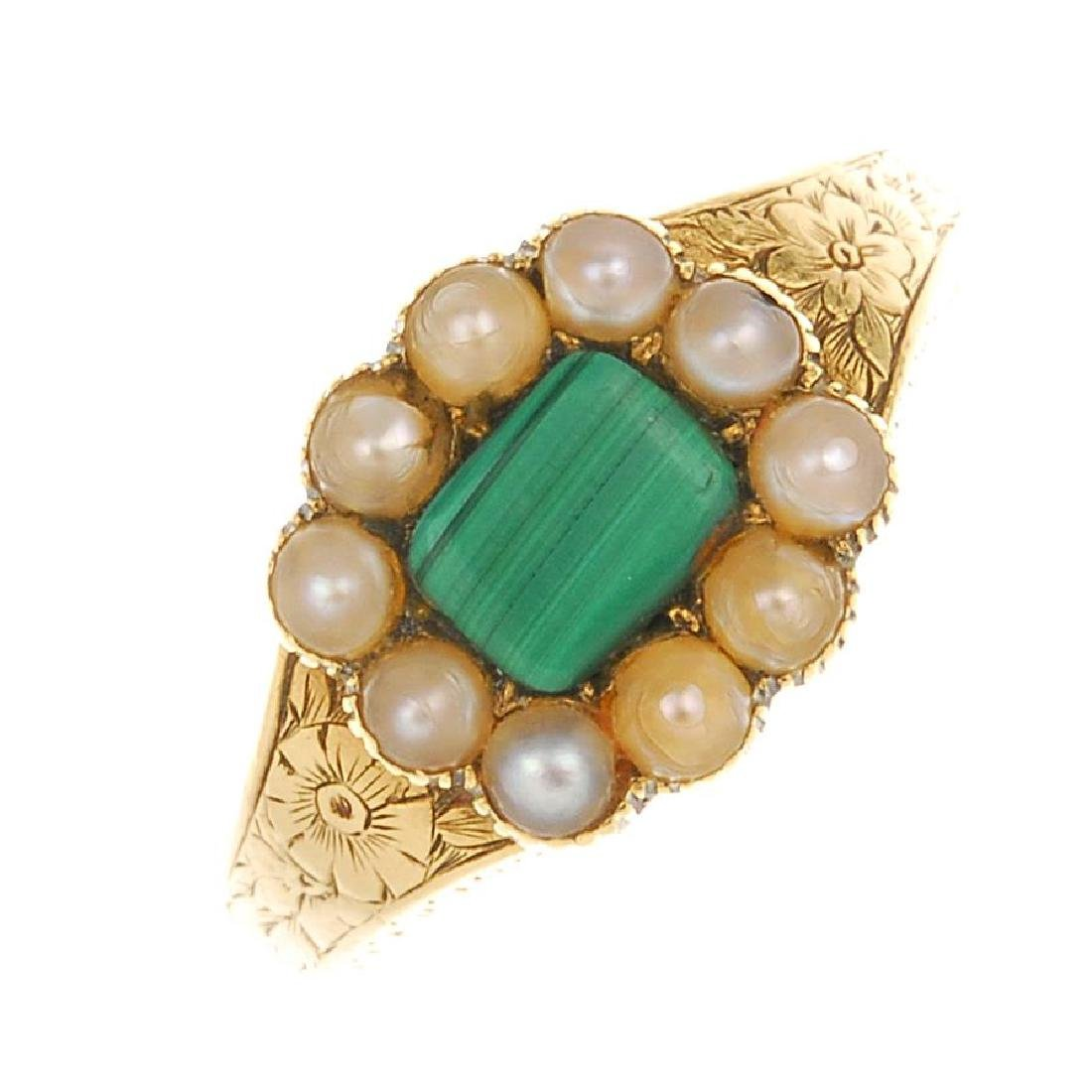 An early Victorian 18ct gold split pearl memorial ring.