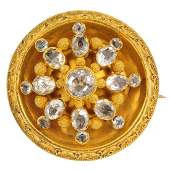 A mid Victorian gemset brooch The varishape quartz