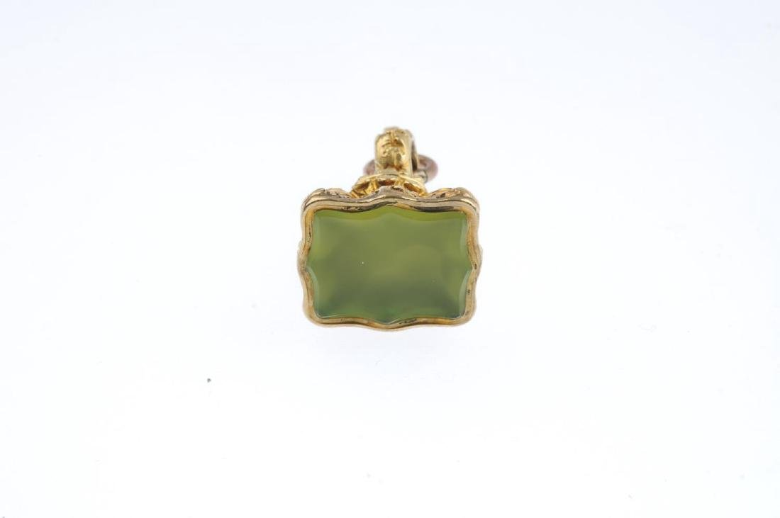 A late 19th century fob. The scalloped green gem panel, - 2