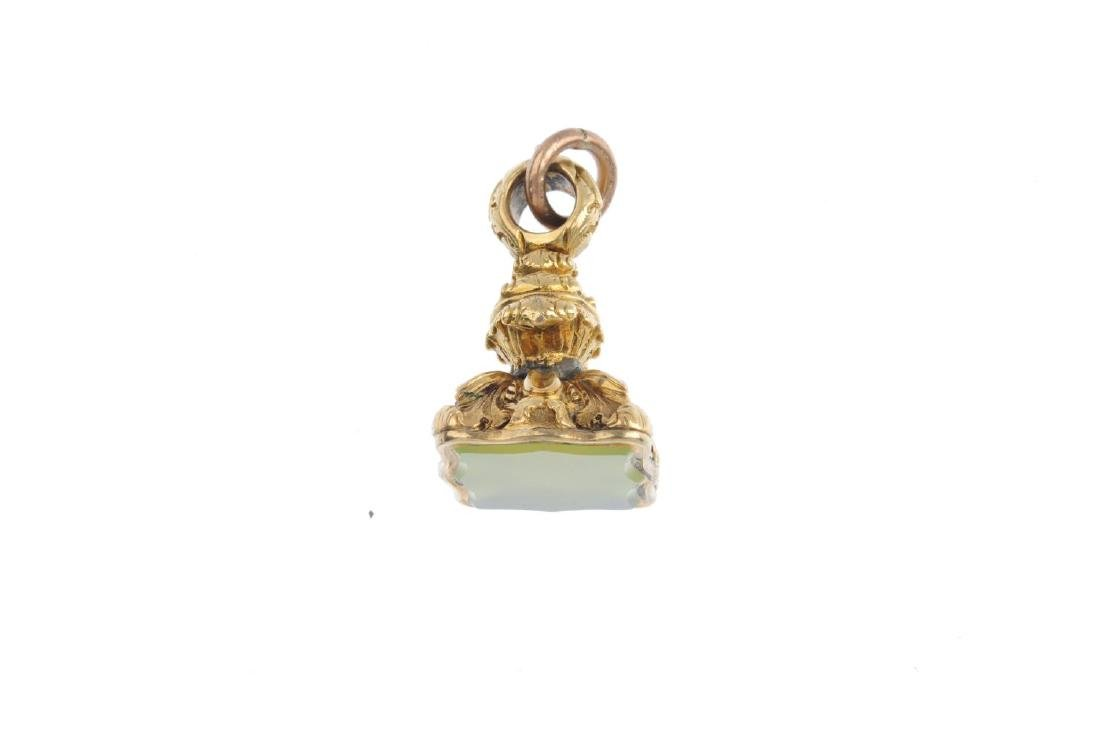 A late 19th century fob. The scalloped green gem panel, - 3
