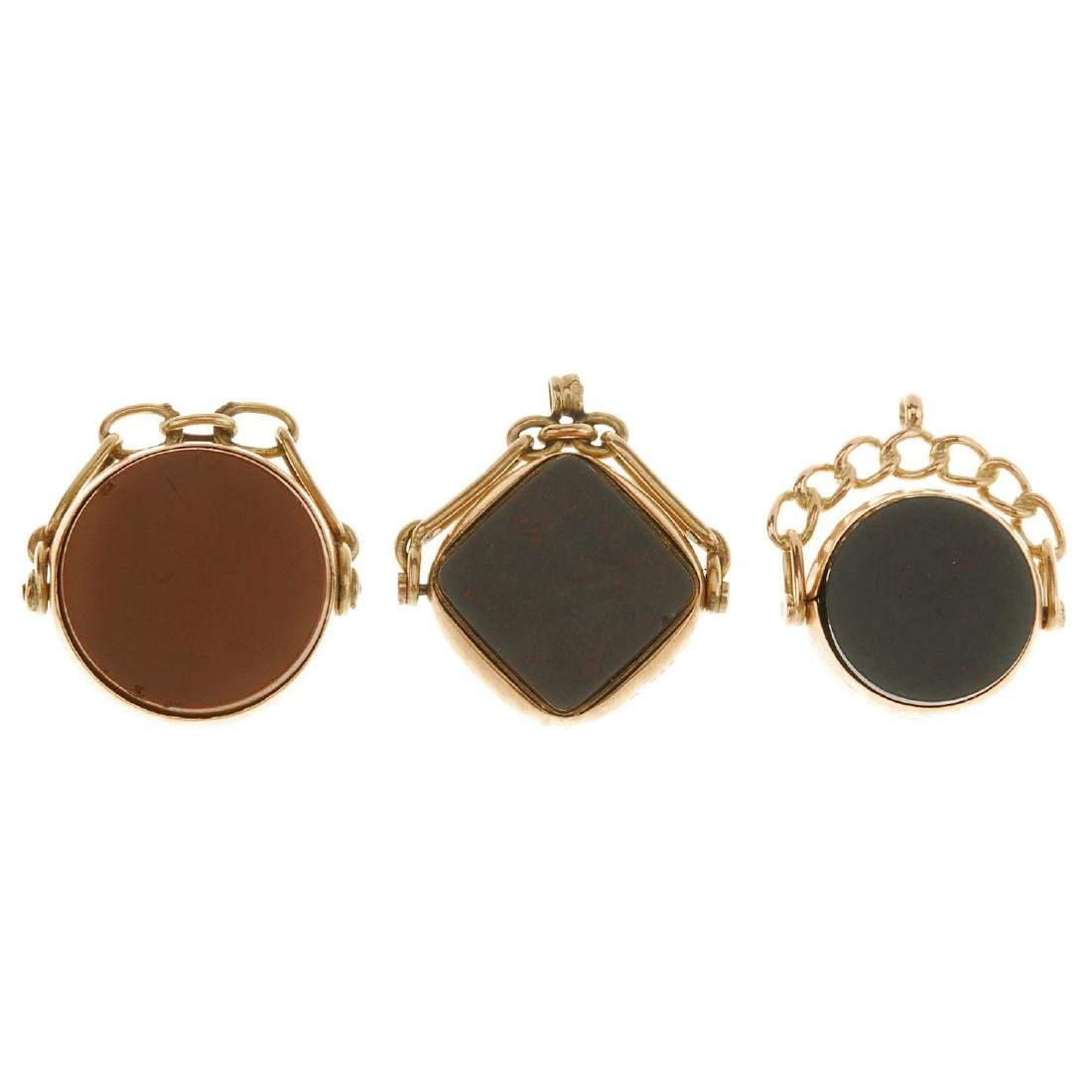 Three 9ct gold swivel fobs. To include one with