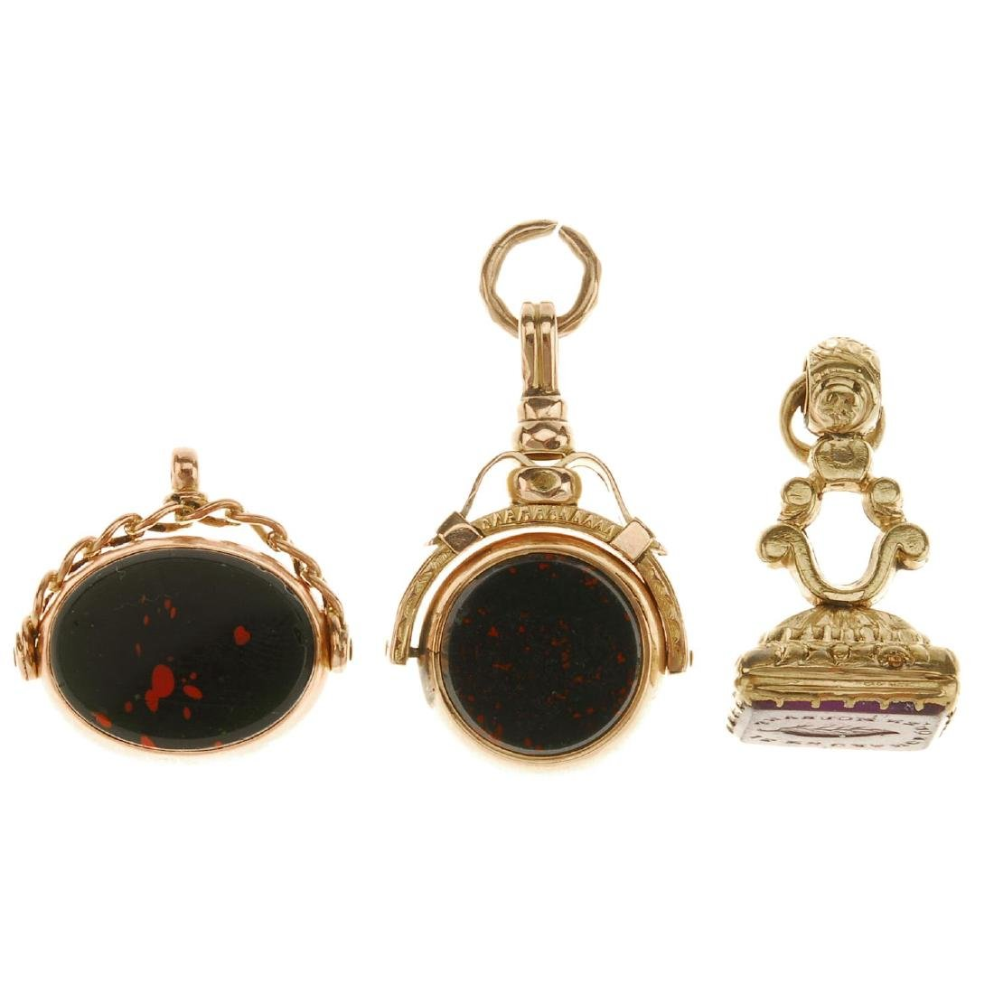 Two 9ct gold swivel fobs and an intaglio fob. The