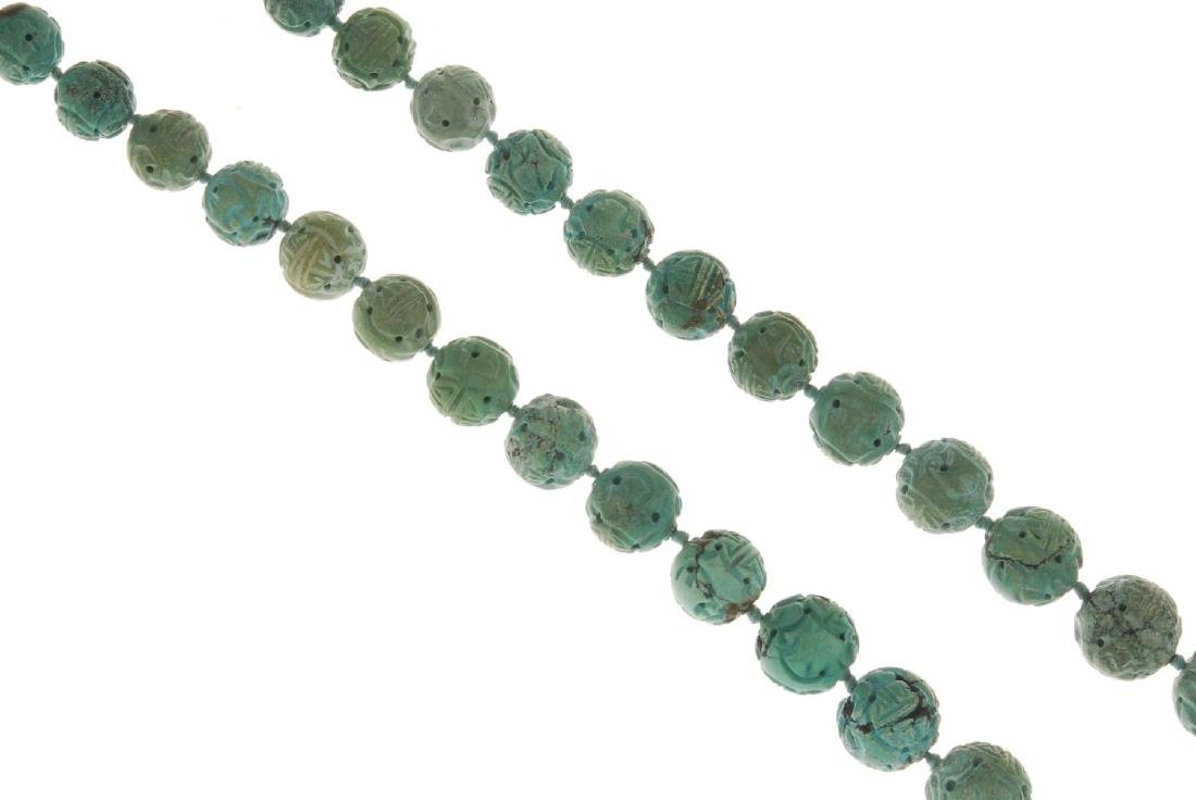 A Chinese Shou carved turquoise bead necklace. - 2