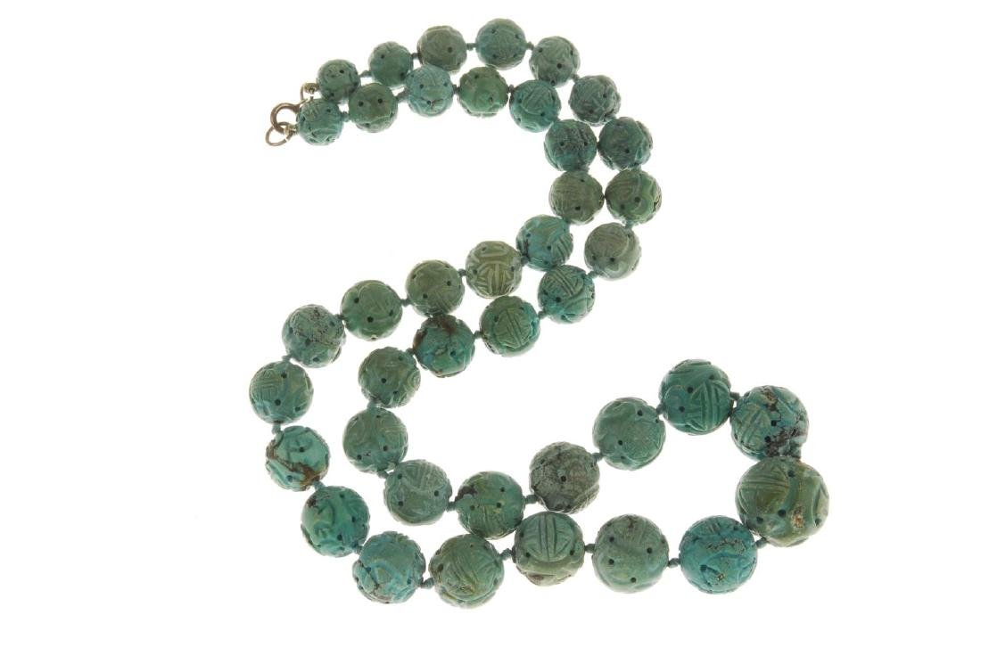 A Chinese Shou carved turquoise bead necklace. - 3