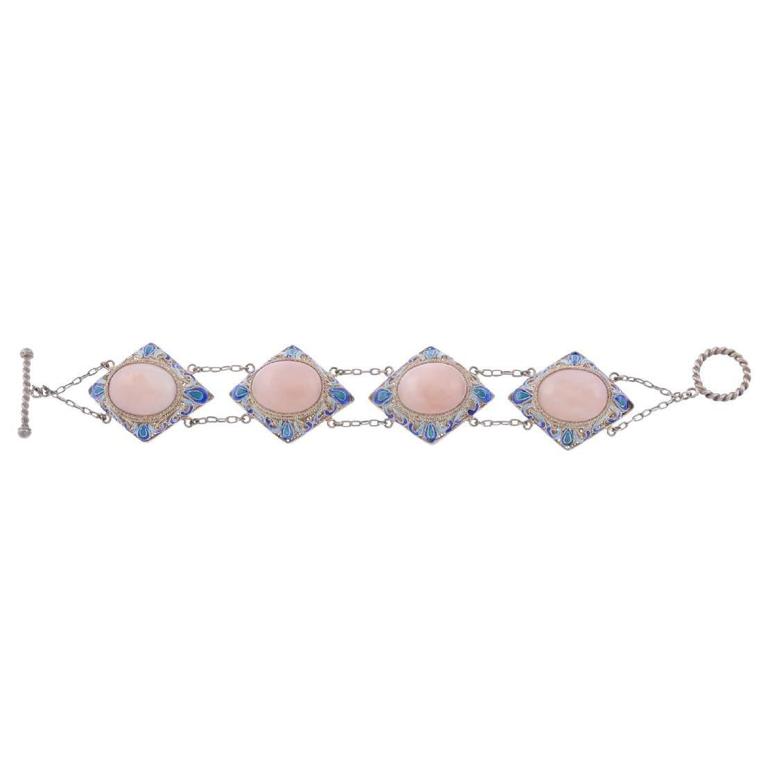 A gem and enamel silver bracelet. Designed as a series