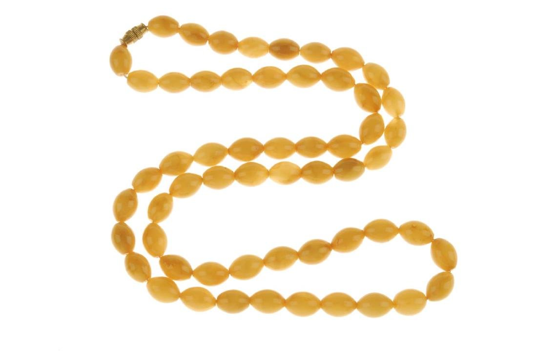 An amber necklace. The single row of amber beads, - 3