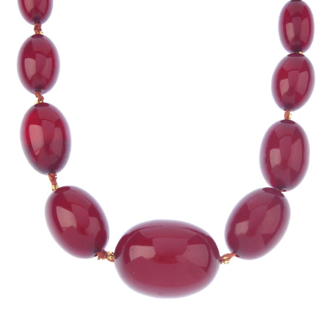 A bakelite bead necklace. Designed as twenty-seven