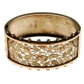 A late Victorian silver hinged bangle The openwork